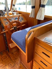 Extended helm seat