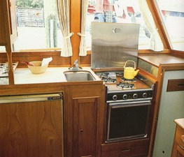 Galley with Princess range, 12V refrigerator/freezer, stainless steel sink
