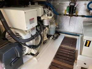 Northern Lights 8kW generator, teak grating in engine room, fiberglass battery box