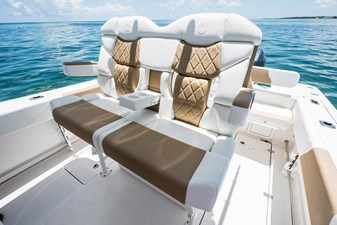 EdgeWater-245cc-Deluxe-Helm-Seatingwith-folding-bolsters-and-armrests