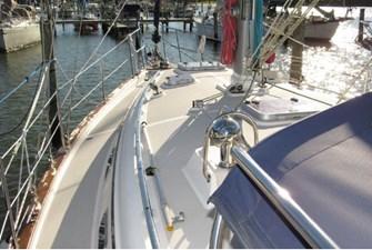 Port side deck and side grab bar on dodger