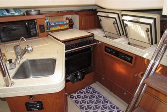 Galley with fridge and freezer open
