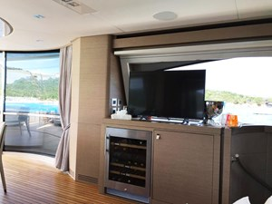 Palgremat 34 TV and wine cooler on the upperdeck saloon