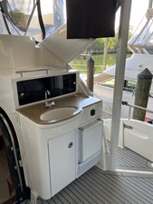 23. UPPER AFT DECK SINK AND TV