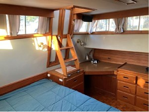 Master cabin doors from aft deck, ladder, desk and storgae
