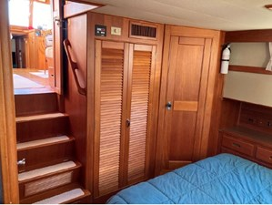Master cabin, steps up to salon, closet and shower room door