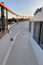 Side deck, teak caprail and hand rail