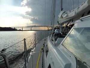 Hard dodger and side deck at dusk