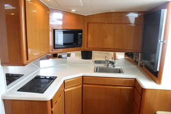 Spacious galley with high gloss varnished teak