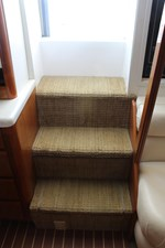 Carpeted stairs with stowage under