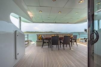 MIA KAI  15 MIA KAI Bilgin Tiago 100 - Looking aft, onto the aft deck with covered dining.
