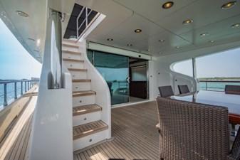 MIA KAI  26 MIA KAI Bilgin Tiago 100 - Aft deck staircase leading up to the flybridge.
