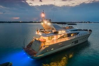 MIA KAI  10 MIA KAI Bilgin Tiago 100 - MIA KAI by night with aft underwater lights blazing in blue.