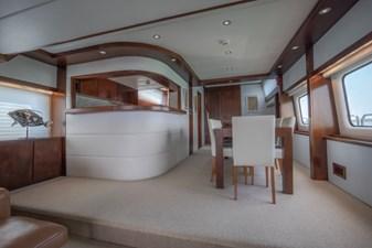 MIA KAI  23 MIA KAI Bilgin Tiago 100 - Main deck galley and bar with formal dining.