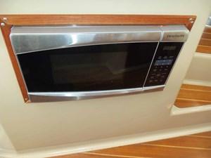 POUR HOUSE 6 Microwave