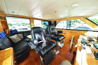 Helm Looking Aft with Desk, TV, Computer and Dining-Cruising-Relaxation-Lounge Area