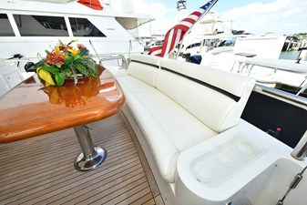 All's Well 24 Main Aft Deck with Generous Seating and Beautiful Teak Dining Table