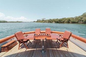 DR. DARK 64 Blue Water Teak Table and Chairs with Offset Base in Cockpit
