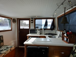 Mobjack 31 Mobjack Salon looking aft- black freezer below counter