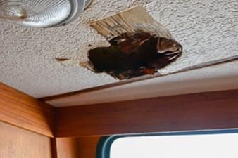 Gabbiano Azzuro 61 60 port ceiling leak damage deck above not core solid glass