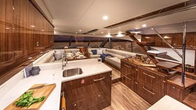 57 enclosed bridge 8 Riviera-57-Enclosed-Flybridge-Saloon-05-Gloss-Walnut-Timber-Finish