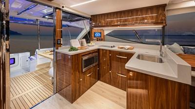50 sports motor yacht  3 Riviera-50-Sports-Motor-Yacht-Galley-01-Gloss-Walnut-Timber-Finish