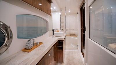 6000 sport yacht platinum 8 Riviera-6000-Sport-Yacht-Platinum-Edition-Master-Ensuite-01-Gloss-Walnut-Timber-Finish