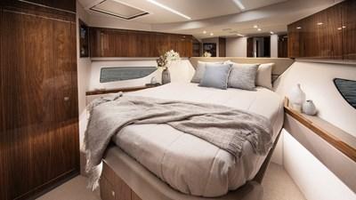 505 SUV  7 Riviera-505-SUV-VIP-Forward-Stateroom-01-Gloss-Walnut