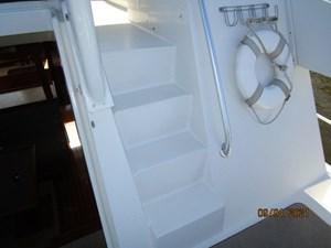 MoWhisky 25 24_2782602_43_mainship_trunk_cabin_flybridge_steps