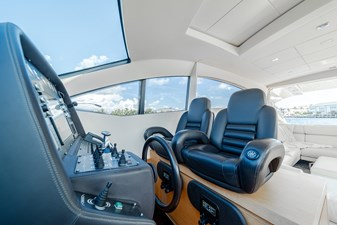 Aretecte 13 Leather Wrapped Steering Wheel and Two Helm Chairs
