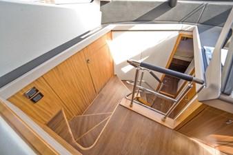 Inner Light 26 2016 Sunseeker 65 Manhattan - Inner Light - Stairs to Staterooms